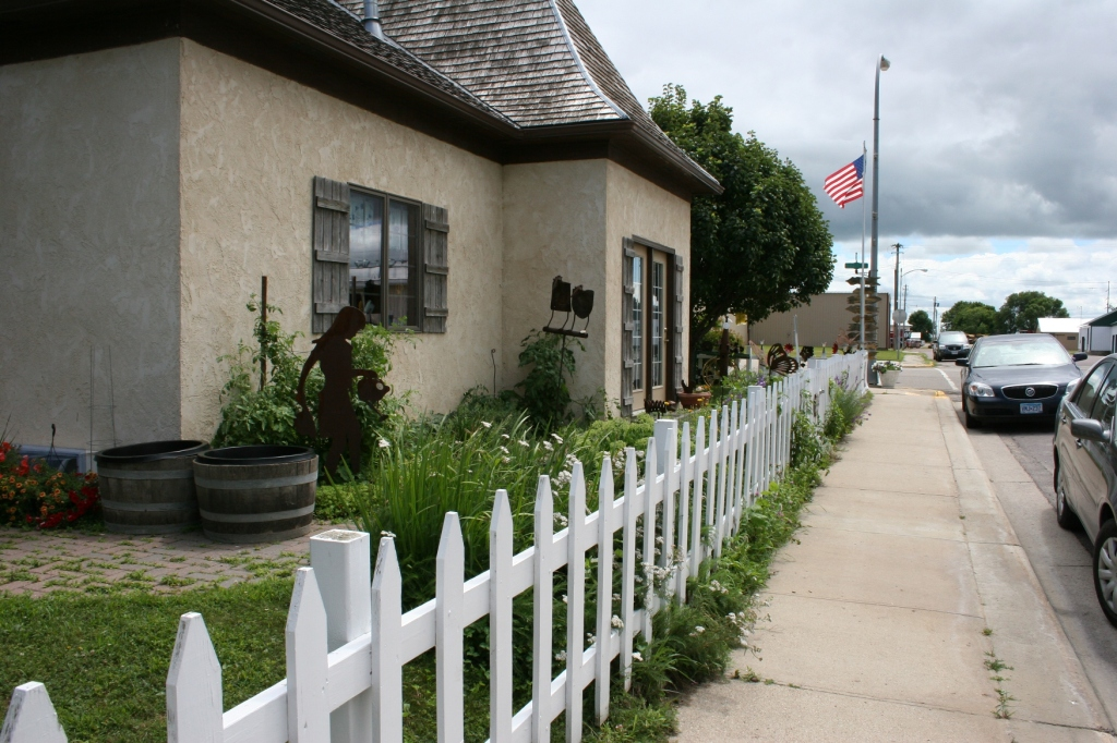 A final parting shot showcases the white picket fence surround this former gas station now turned European style eatery.