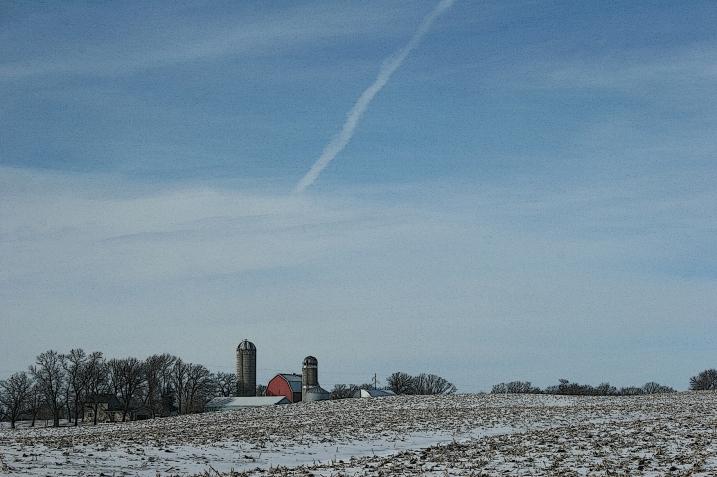 The rural scene unfolds before us.