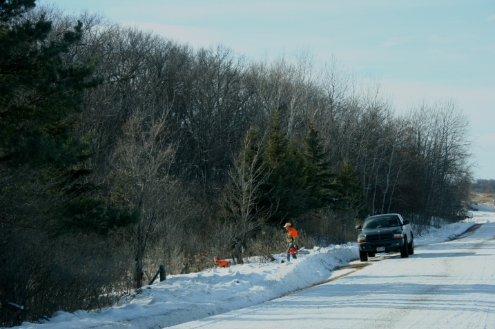 While some played, others worked. This guy prepares to saw wood along a rural roadway.