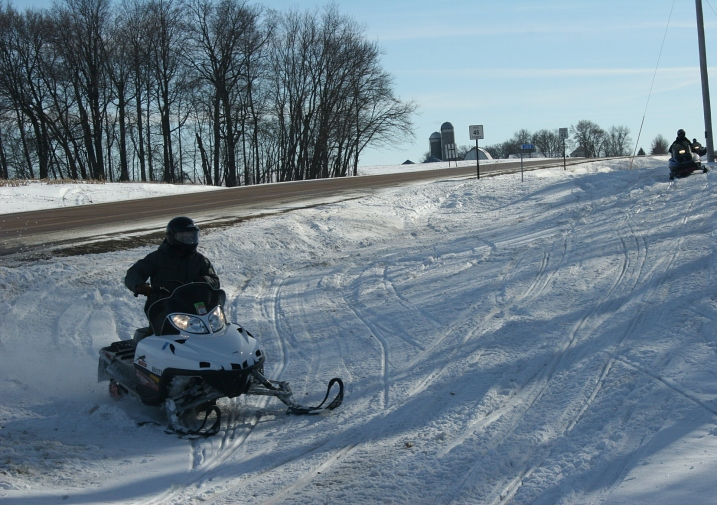 These Minnesotans preferred driving their snowmobiles in the ditch along a Rice County Road.