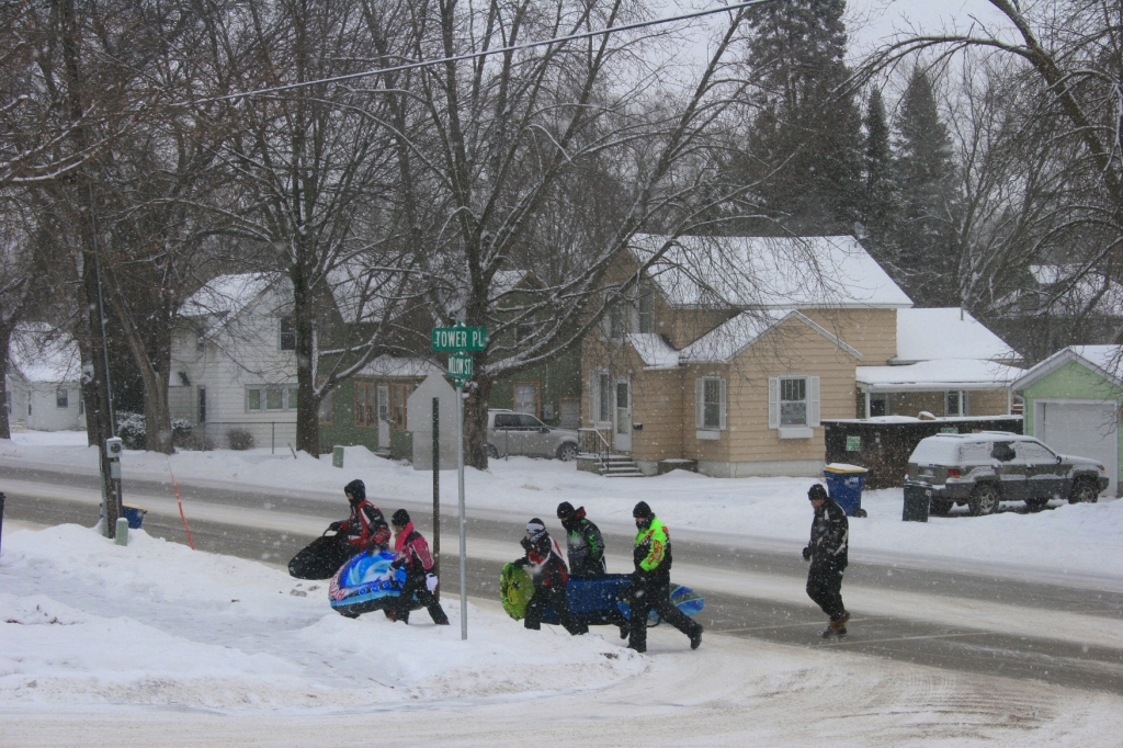 I photographed these winter enthusiasts heading up the hill to the park to go sledding.