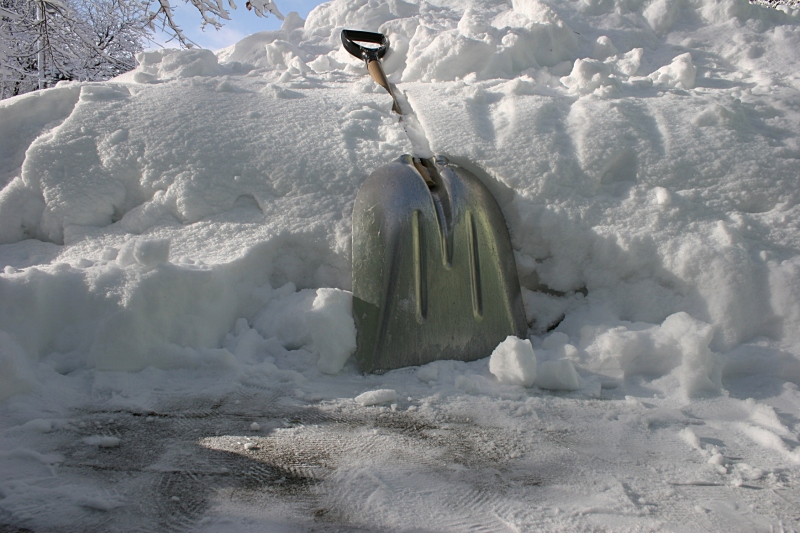 A scoop shovel worked best for removing this snow. I shovel where the snowblower can't go.