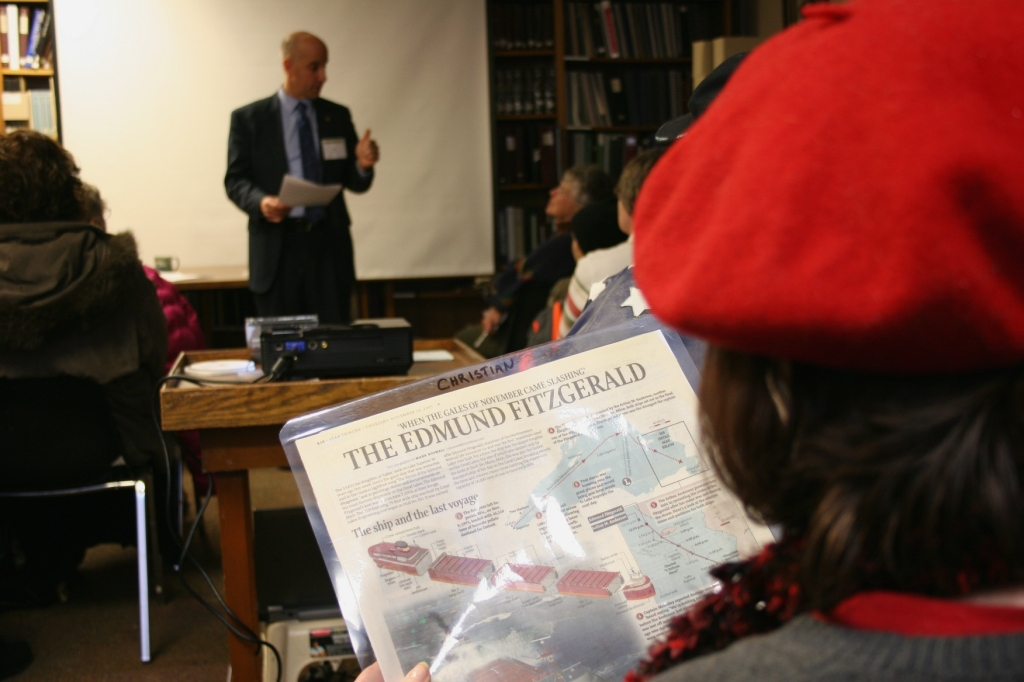 Newspaper clippings about The Fitz were passed among audience members while Jim Christian spoke.
