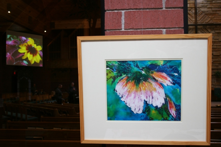A floral batik by Arlene Rolf graces a wall in the narthex. Inside the sanctuary, my flower photos are showcased on the screens.
