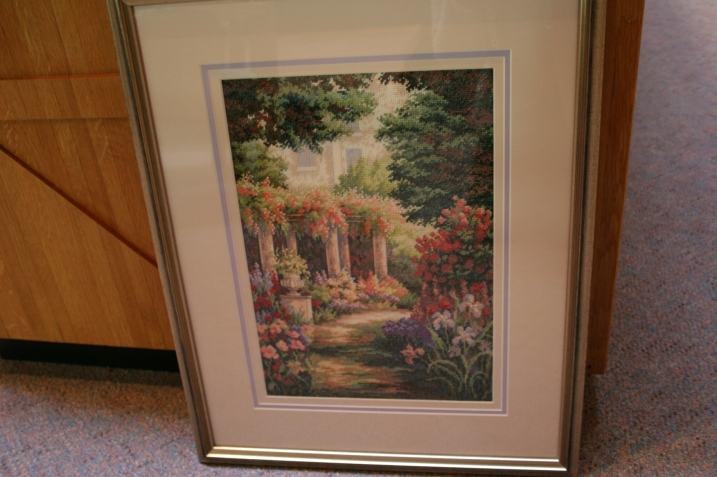 Church secretary Jennie Kingland created this lush detailed floral in counted cross stitch.