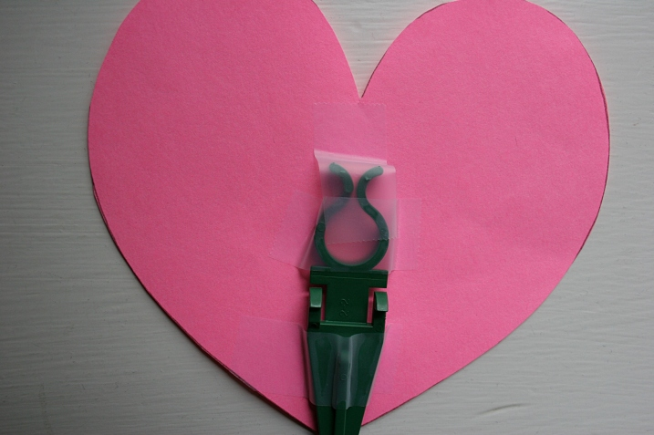 Each paper heart was secured to a plastic stake with regular tape.