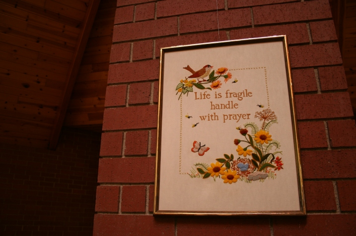 This same hand-embroidered art, displayed in church, hangs above my bed.
