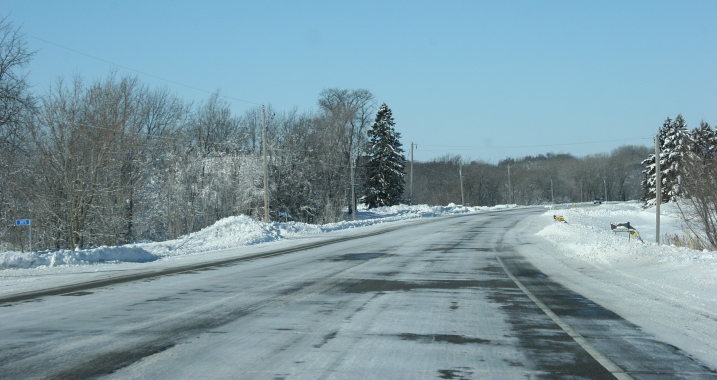 Minnesota Highway 60 just outside of Faribault Saturday morning shows a mostly snow-packed highway with a few patches of pavement showing.