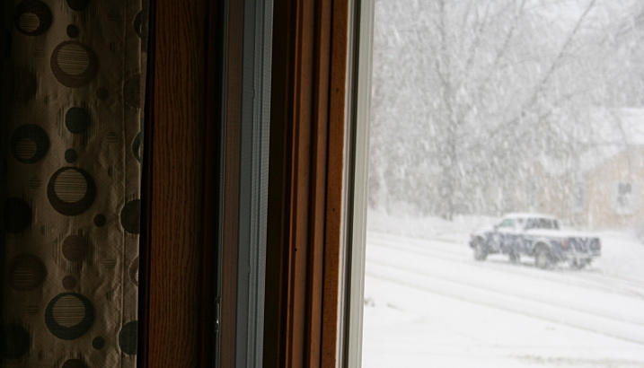 As I snapped this photo from my living room window, this pick-up truck slid on the snowy street.