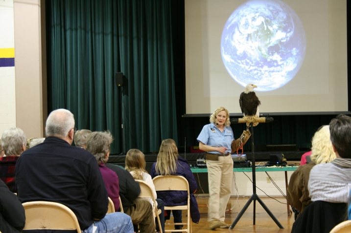 A bald eagle was part of the show in the gym. No, it did not fly.