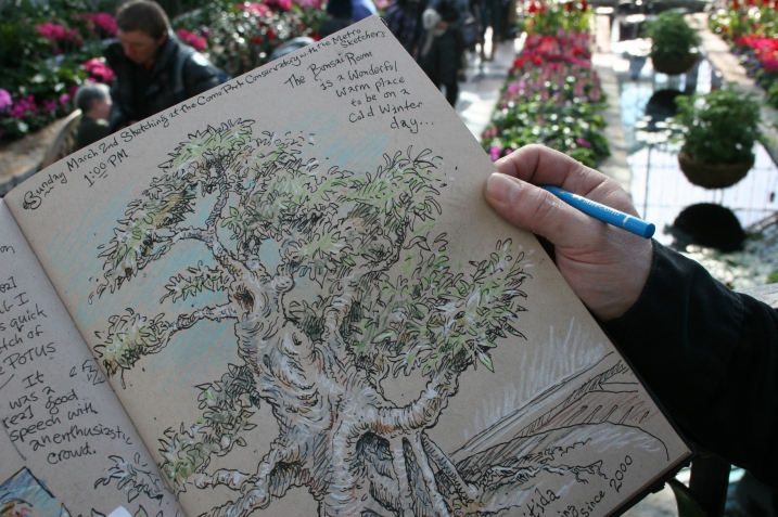 An artist sketching in the Sunken Garden flipped his sketchbook back to reveal his favorite sketch of the day, that of a bonsai tree. His art is spectacular.