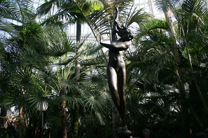 Admire the art, including this statue in a Palm Dome fountain.