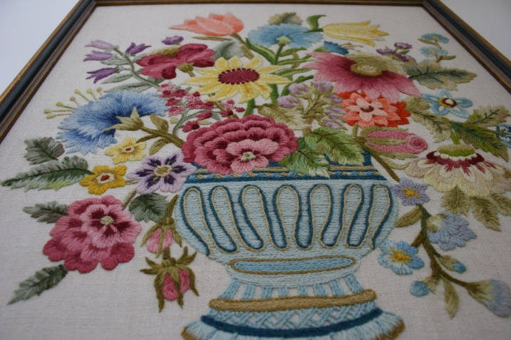 Crewel embroidery floral art, looking up