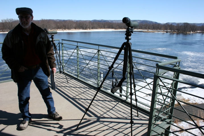 A second story observation deck outfitted with numerous binoculars, allows visitors to view the eagles along the Mississippi River.