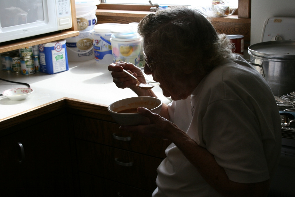 Elsie, 88, enjoys a bowl of bean soup.