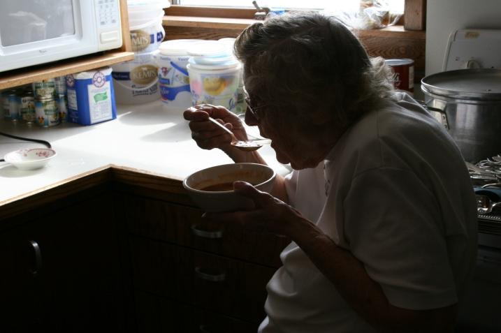 Elsie, 88, enjoys a bowl of bean soup.