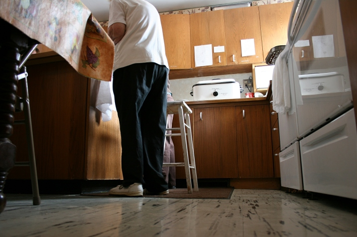 Inside the church kitchen, that's Elsie standing next to her stool.