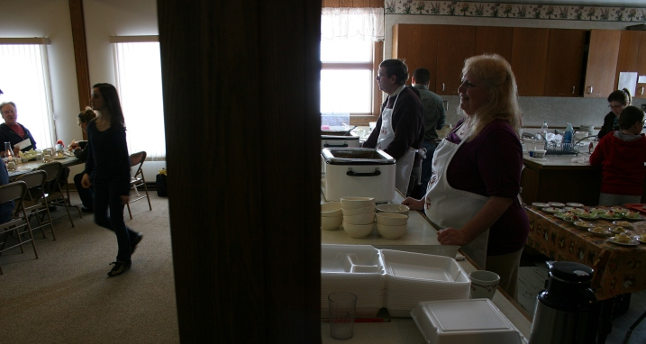 Lynn, right, tends the potato soup in this duo scene of kitchen and fellowship hall.