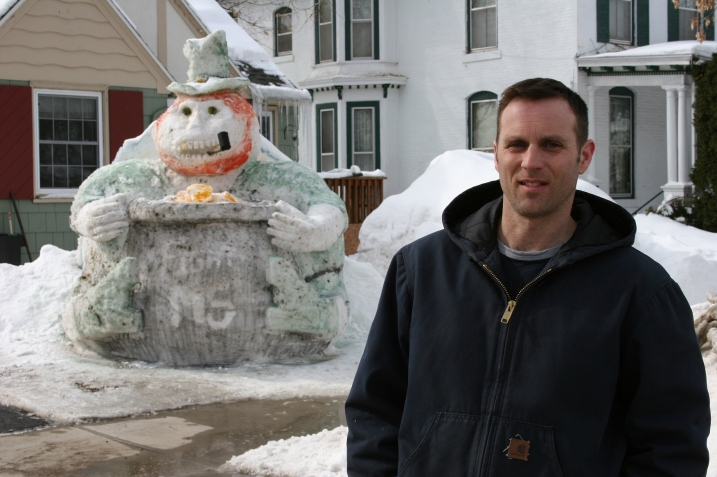 Faribault resident Kurt Klett and his latest snow sculpture, a leprechaun with a pot of gold.