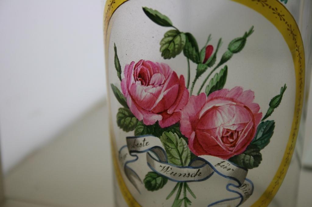 Detailed floral art on glassware.