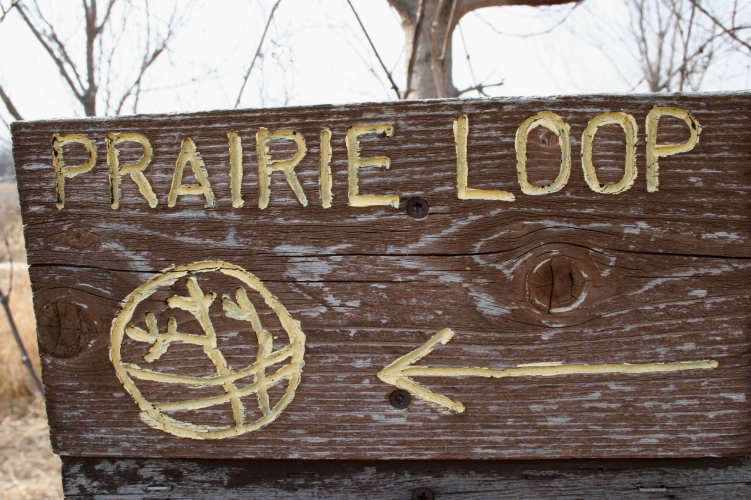 Handcrafted signs guide visitors along trails.