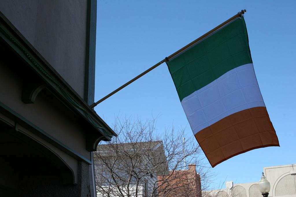 The Irish national flag flies outside the pub.