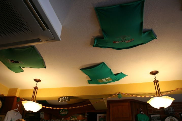 T-shirts on the pub ceiling.