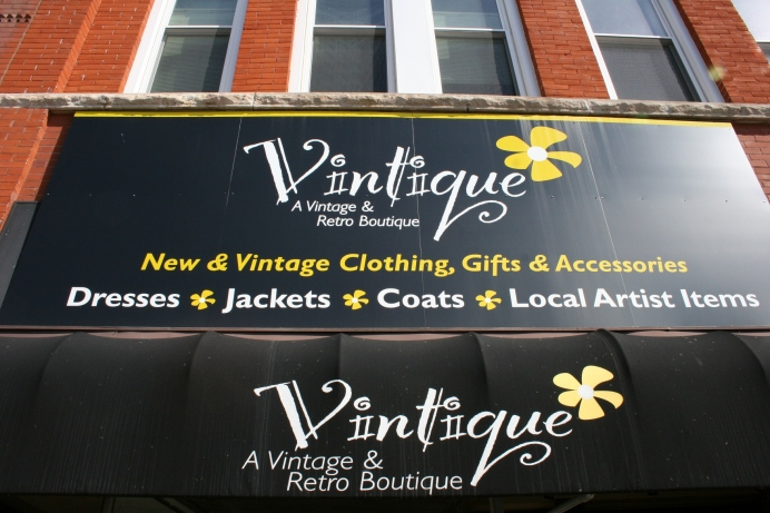 The signage on Vintique, 131 West Wisconsin Avenue, Neenah, Wisconsin.