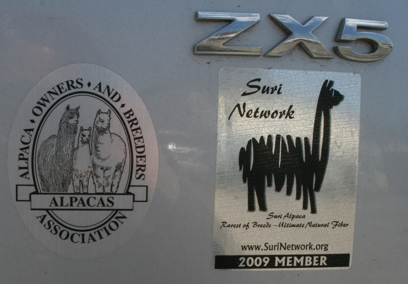 Stickers on a vehicle parked outside Four Seasons Centre.