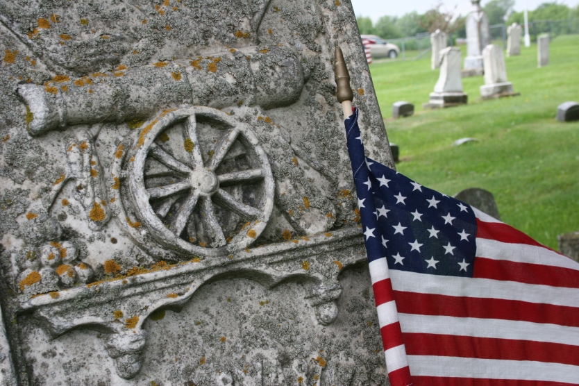 An art appropriate cannon marks a Civil War Veteran's tombstone in the Cannon City Cemetery.