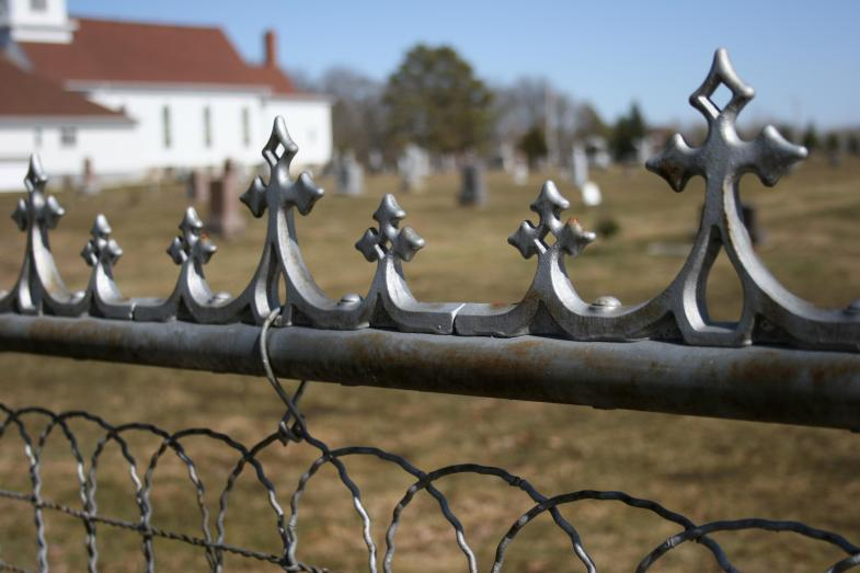 A fence surrounds the Urland Lutheran Church Cemetery in the Sogn Valley area.