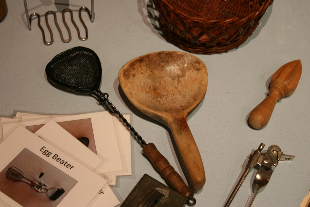 Old kitchen utensils for visitors to identify.