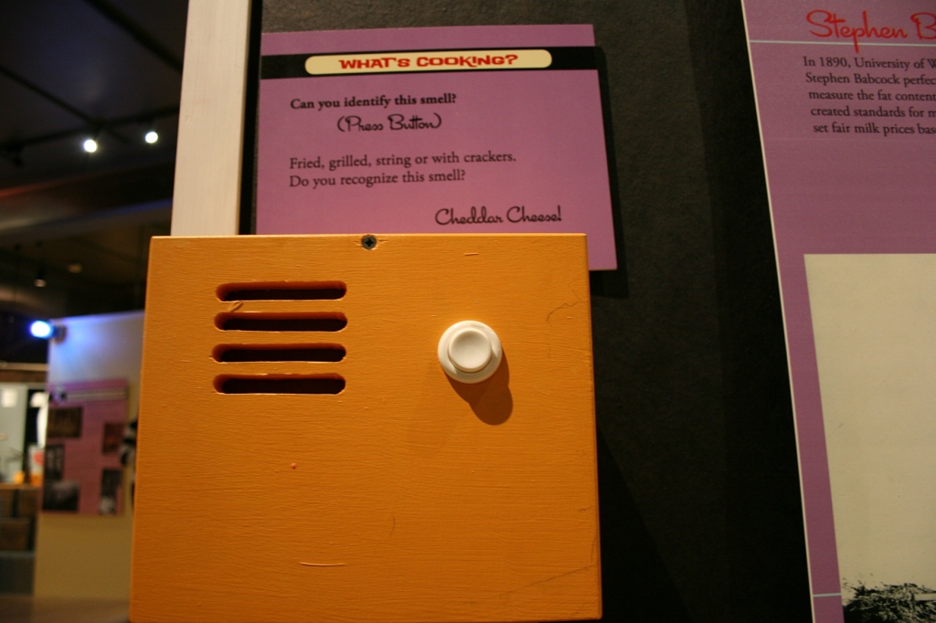 Via museum magic, you can actually press the button and smell cheddar cheese wafting from the golden box.
