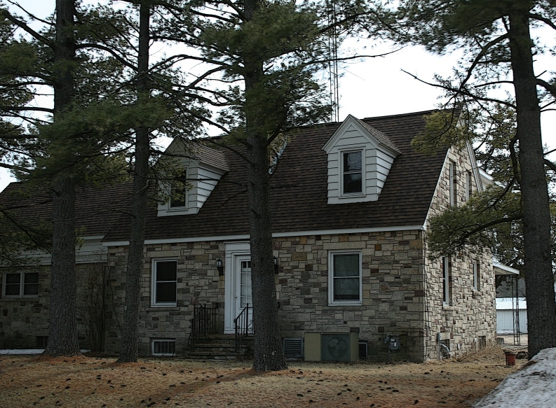 A stunning Cape Cod style home constructed from locally quarried stone near Redgranite, Wisconsin.