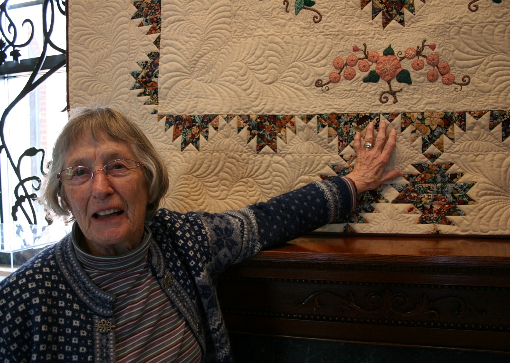 """Artist Lois Doyle created """"Mountain Laurel,"""" a quilt she started 25 years ago. She has several quilts in the show. Laurie Spindler machine quilted this quilt."""