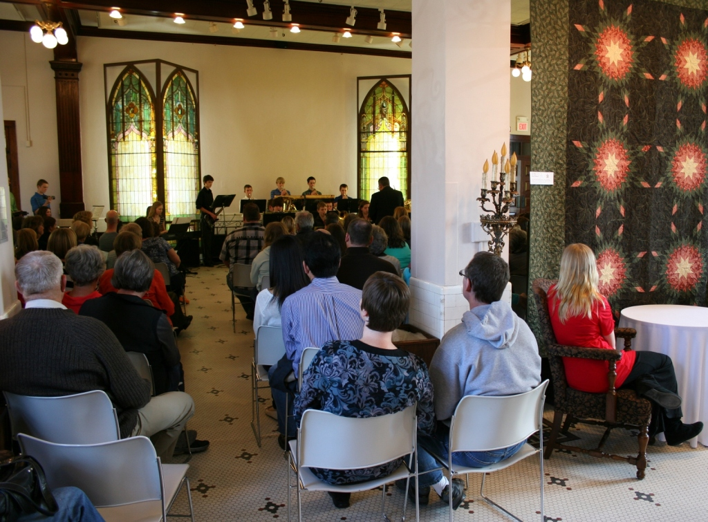 During the open reception, musicians performed in the venue space, where several quilts are displayed.