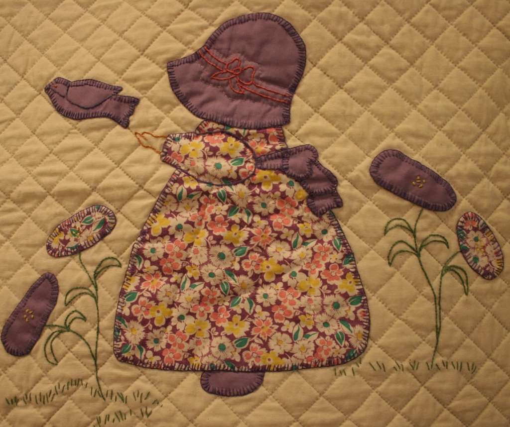 This block from the 1930s Sunbonnet Sue pattern features quilting and embroidery.