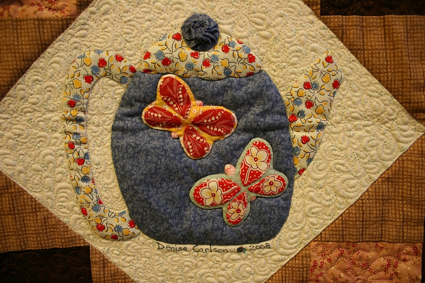 A block in a teapot themed quilt.