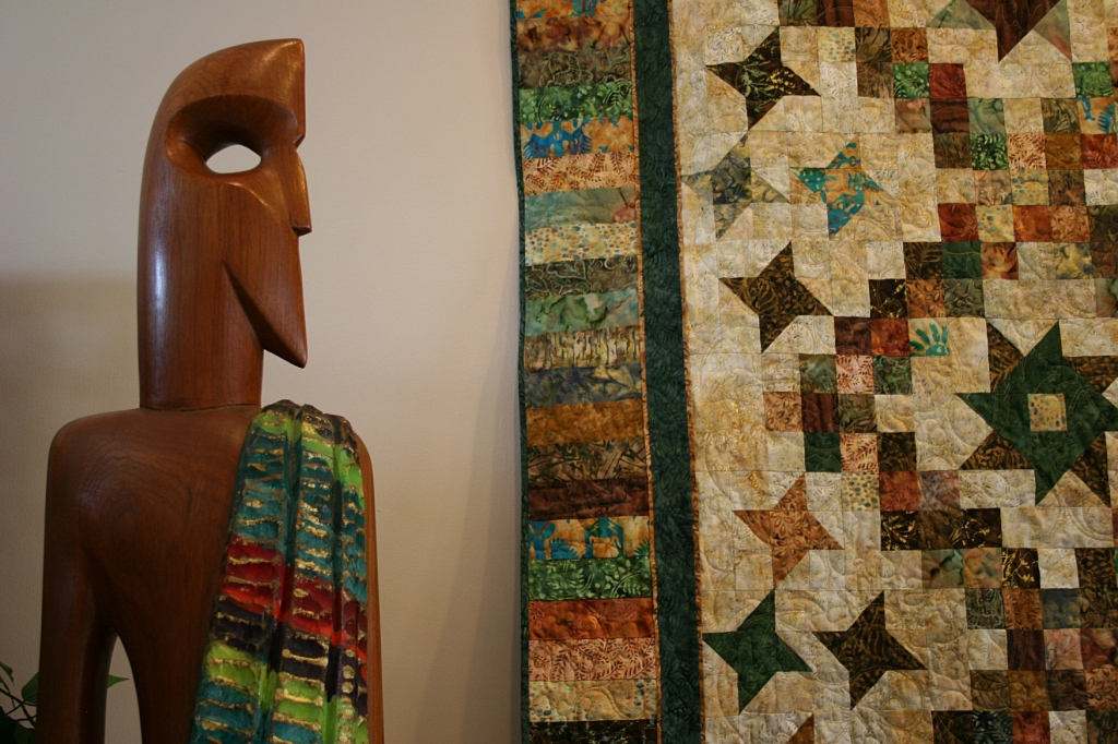 I really liked this pairing of wood sculpture with quilt art. The wood tone compliments the earthy colors of the quilt.