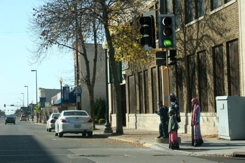 A Somali family waits to cross a street in downtown Faribault. Minnesota Prairie Roots file photo 2010.