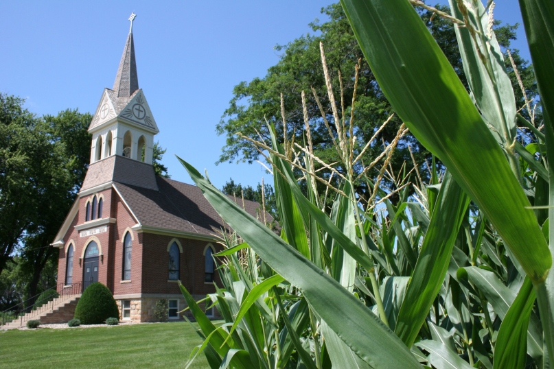 Fields and a cemetery embrace many country churches like Vista Evangelical Lutheran Church in southern Minnesota.
