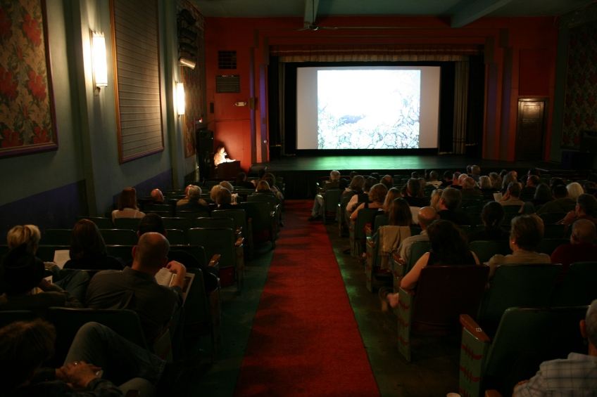Inside the historic State Theatre, artists and poet presented to a nearly full house.
