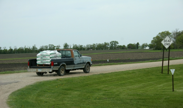 Field work, truck w seed bags west of Mankato