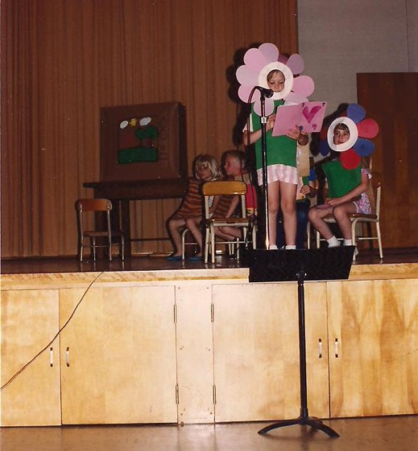 "My eldest stars as a flower in the May 1992 school play, ""Leo the Late Bloomer."""
