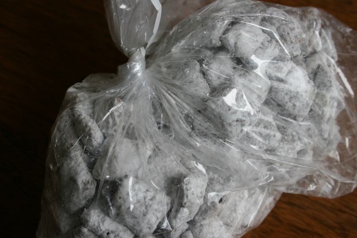 Yummy puppy chow bagged and placed inside a decorated brown paper bag.
