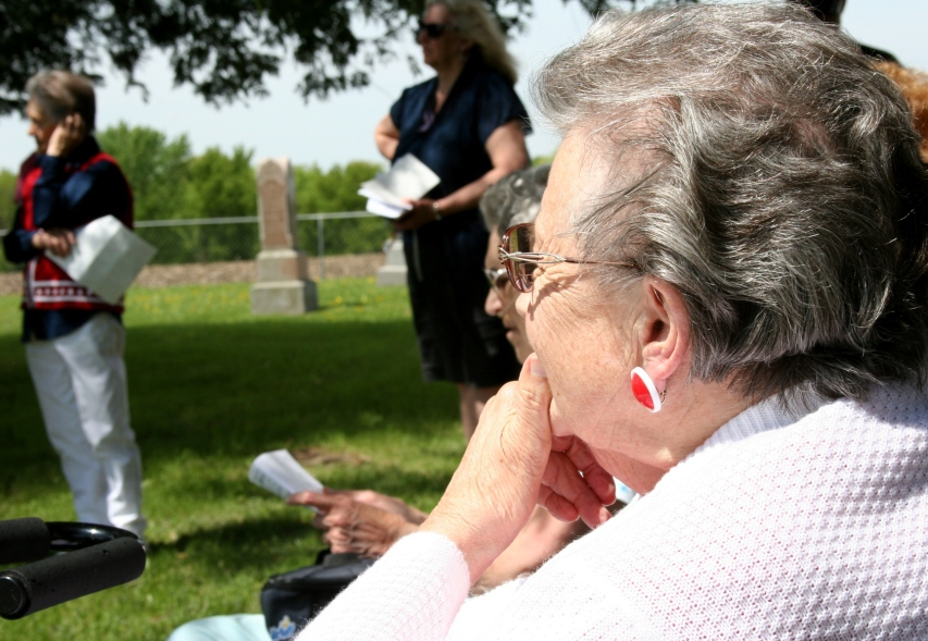 "Jean Pederson listens after reciting ""In Flanders Fields."""
