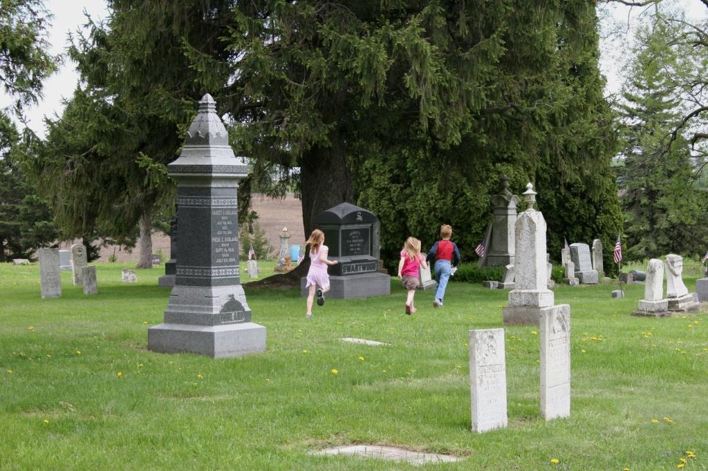 Off to pick dandelions among tombstones.
