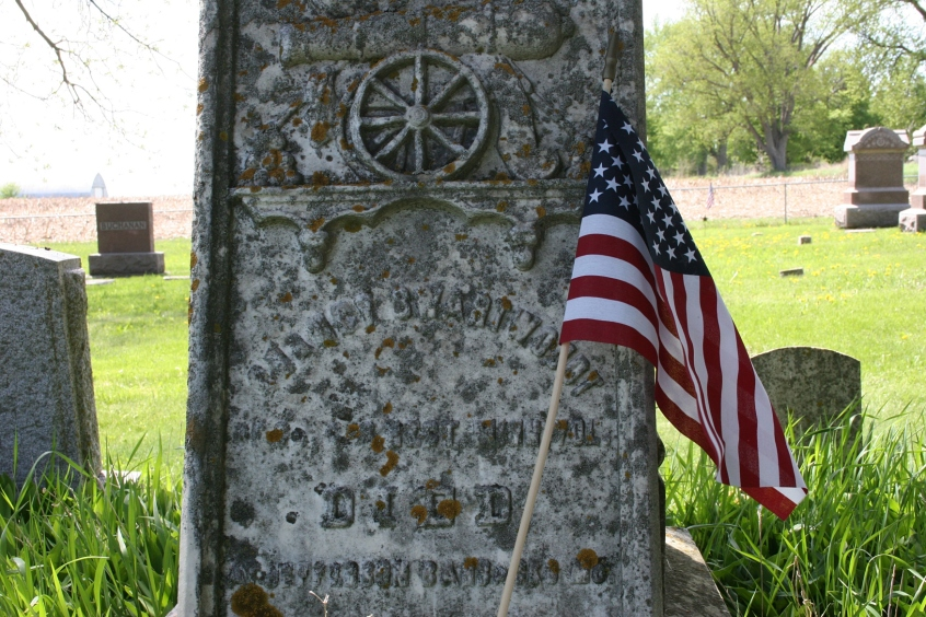 A soldier's grave, flagged for Memorial Day.