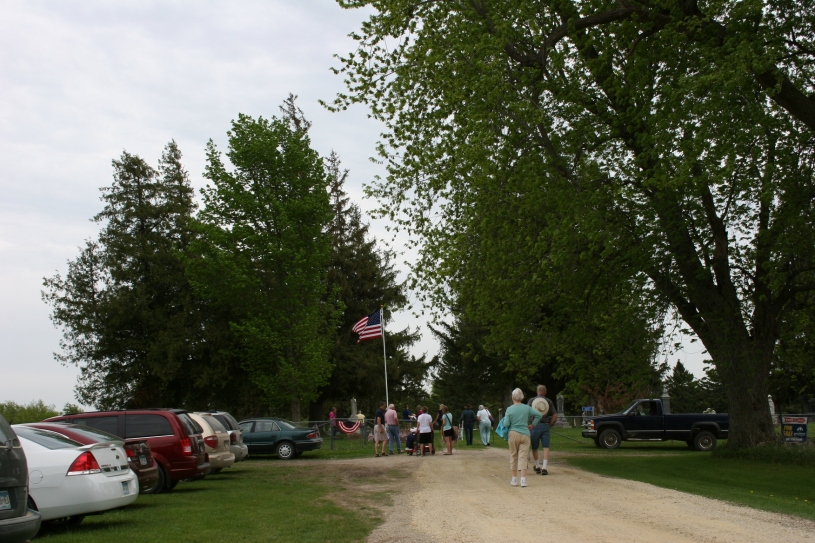Folks begin arriving for the 2 p.m. Memorial Day program at the Cannon City Cemetery.
