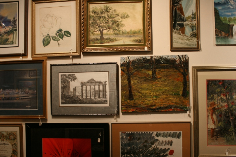 Originals and prints fill the gallery walls.